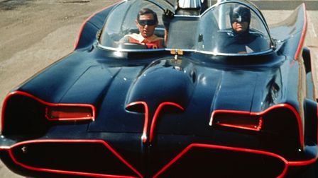 Batman and Robin (AdamWest and Burt Ward) in the Batmobile in the 1966 TV series Photo: Channel 5