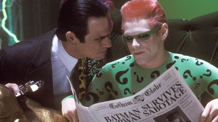 Batman Forever with Tommy Lee Jones as Harvey Dent/Two-Face conspiring with Jim Carrey as The Riddle