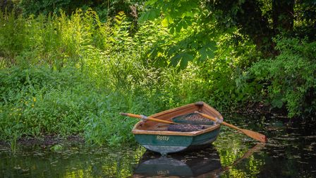 'Ratty' the rowing boat on the River Chelsworth Picture: APRIL URAQUHART