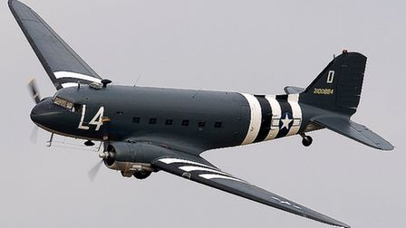 A Douglas C-47 Dakota with the black and white markings used by Allied forces during the D Day landi