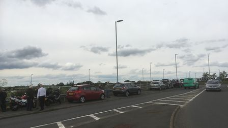 Crowds gathered on the bridge over the A12 at Colchester United FC to watch the flypast. Picture: AR