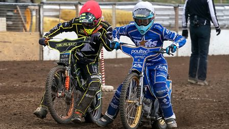 Ipswich's Krystian Pieszczek (red helmet) and Lynn's Ty Proctor bumping elbows on the way from the t