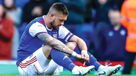 Luke Chambers slumped on the Portman Road pitch following Town's relegation at home to Birmingham.