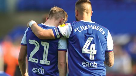 STORY ONE Skipper Luke Chambers puts an arm around Flynn Downes at the final whistle in the loss to