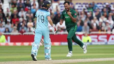 Pakistan's Wahab Riaz celebrates taking the wicket of England's Chris Woakes during their World Cup