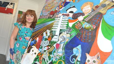 Michelle Deyna Hayward with her portrait of Ed Sheeran, which is currently on show at the Carousel G