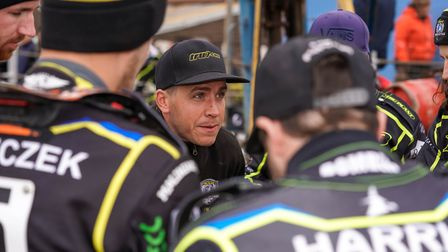 Ipswich Witches team manager Ritchie Hawkins holds a pre-meeting team talk with his flying speedway