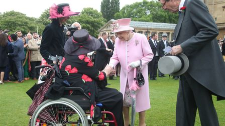 The Queen and margaret Baxter at the Royal Garden Party at Buckingham Palace. Picture: Yui Mok/PA Wi