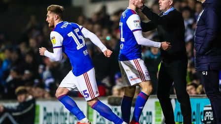 Substitute Teddy Bishop runs onto the pitch as a departing Flynn Downes is embraced by Ipswich Town
