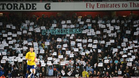 Coventry City fans hold signs in the stands as a protest against the club. Photo: PA