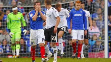 David Norris (centre left) looks dejected as Portsmouth head towards Championship relegation in 2009