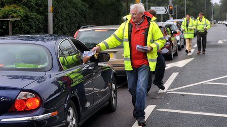 Mike Brown and other campaigners pictured in 2010 handing out leaflets calling for a dualled A11. Pi