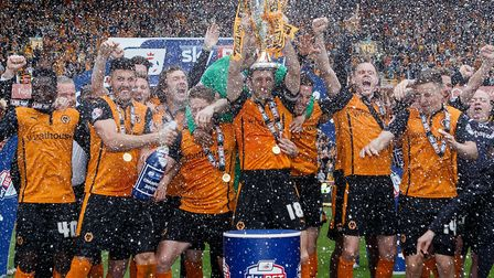 Wolverhampton Wanderers' captain Sam Ricketts lifts the League One trophy. Photo: PA