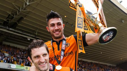 Wolverhampton Wanderers' Sam Ricketts (bottom) and Danny Batth celebrate promotion back to the Champ