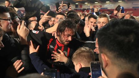 Bradley Dack is mobbed by fans as Blackburn Rovers get promoted back to the Championship. He scored
