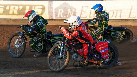 Danny King (blue helmet) and Richard Lawson getting the better of Rohan Tungate last week. Pictur