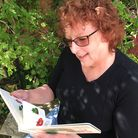 Lynne with the board book version of The Very Hungry Caterpillar. Picture: Ruth Ellis