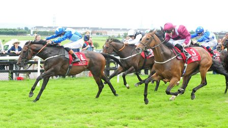 Safe Voyage ridden by Sean Davis (right) got the better of Mankib at Haydock last time out - but Ror