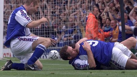 Magilton celebrates a goal against Sheffield United in 1999 with David Johnson and James Scowcroft.