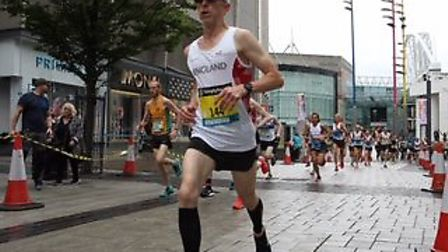 Chris Cooke, running in an England vest at the Great Birmingham 10K