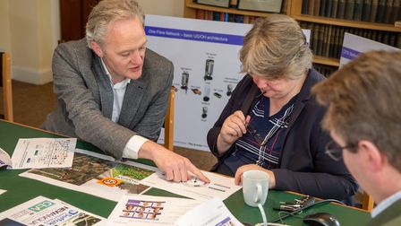 Openreach's Kevin Murphy talking Suffolk Coastal MP Therese Coffey through the fibre build Picture: