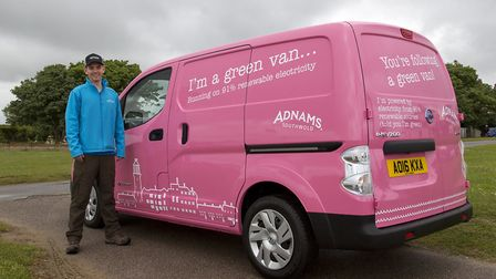 Benedict Orchard with Adnam's electric Nissan van. Picture: SARAH GROVES