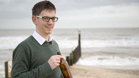 Mr Orchard with one of Adnams' lightweight beer bottles Picture: Sarah Groves