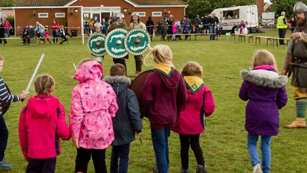Children v Anglo Saxon warriors at the Rendlesham show Picture: Foyers.Photography