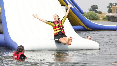 Sliding fun at Aqua Park Suffolk - one of the ultimate days out this summer Picture: SPOTTYDOG COMMU