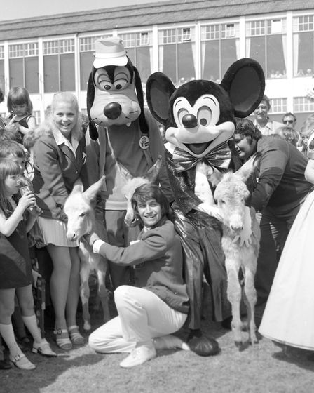 Goofy, Mickey, two donkeys, Redcoats and young fans - a real holiday atmsophere at Butlins holiday p