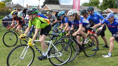 Enthusiastic dads push off the Under 12s at the West Suffolk Wheelers grass track meeting. Picture: