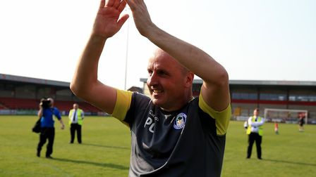 Wigan Athletic's manager Paul Cook celebrates his sides promotion back to the Championship. Picture: