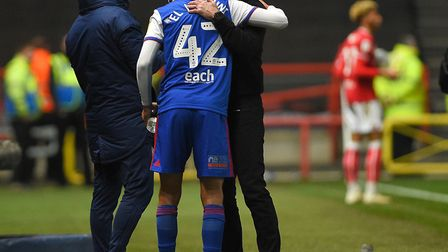 New boy Idris El Mizouni comes off the bench at Ashton Gate and gets a good luck hug from manager P
