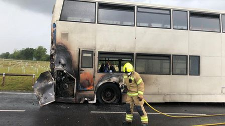 A bus with more than 50 children on board set fire near Bury St Edmunds Picture: SUFFOLK FIRE AND RE