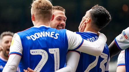 Luke Chambers congratulates Andre Dozzell after he had scored early in the second half to put Town i