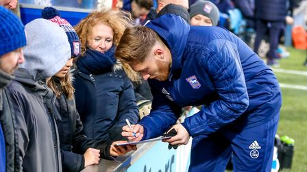 Teddy Bishop signing autographs for Town fans. A hat-trick in the play-off final at Wembley next yea