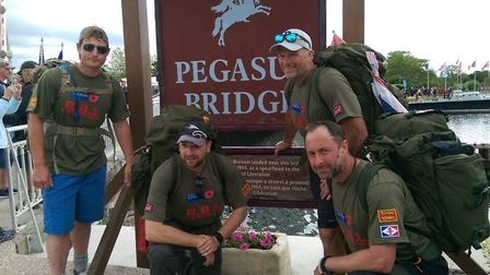 Rich Smith, left, Steve Bailey, Mark Gilly and Alex Holmes reach the end of the trek at Pegasus Brid