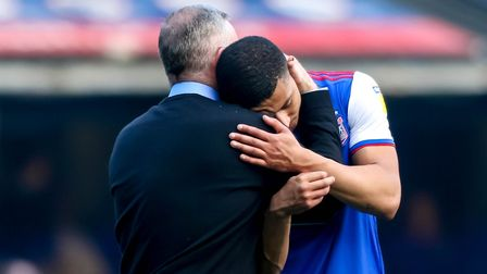 Town manager Paul Lambert embraces Myles Kenlock after the final whistle against Hull. Picture: S