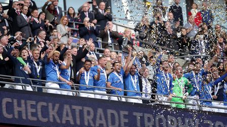 Portsmouth players lift the trophy during the Checkatrade Trophy Final at Wembley Stadium, London.
