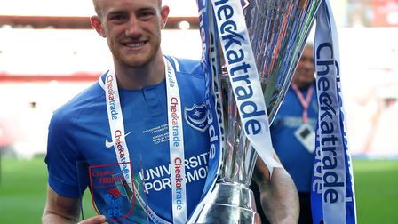 Matt Clarke, pictured with the Checkatrade Trophy, looks set for a big move away from Portsmouth thi