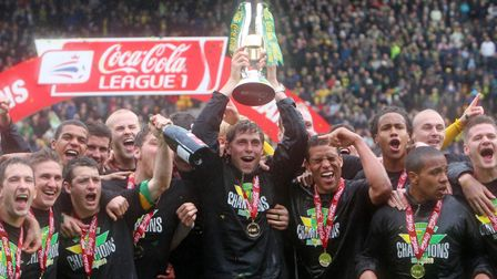 Grant Holt lifts the League One trophy at the end of his debut season with Norwich City. Photo: PA