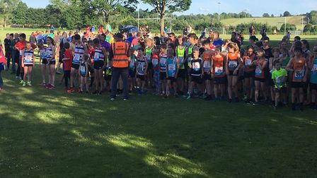 Runners congregate for the start of the junior race at the Sudbury Friday Five event. Picture: CARL