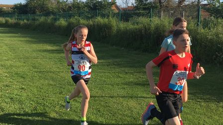 Action from last night's Sudbury Joggers' junior race, held from Great Cornard Sports Centre. Pictur