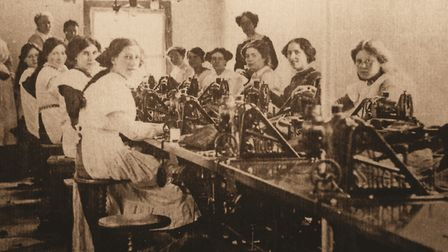 The workroom at the Rowhedge branch of the Colchester Manufacturing company, in about 1912 Picture: