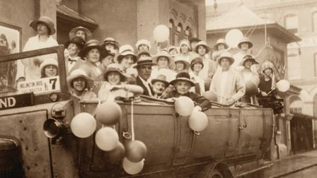 In this view from the 1920s, workers from Hollingtons are outside the Vaudeville cinema (later the