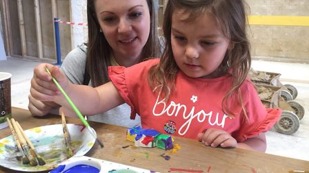 Hannah and Lottie Banyard try out a painting challenge Picture: JOHN NICE