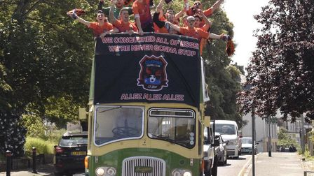 Sunday league team Duckpond FC parade through the streets of Harwich on the open top bus Picture: DU