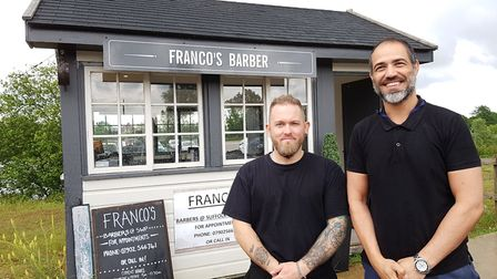 Gianni Falcucci (right) with barber Kelvin Watt, says he is happier after leaving Upper Orwell Stree