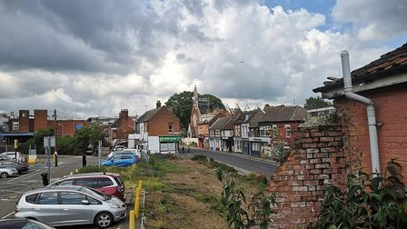 A view crumbling walls, derelict shops and the burnt St Michael's Church in Upper Orwell Street Pict