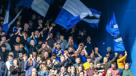 Town fans will be in good voice at grounds they have rarely been to next season. Photo: STEVE WALLER